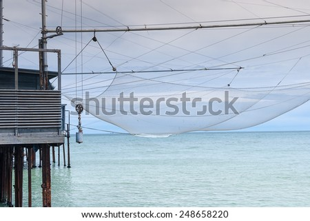 Fishing House with huge net near cost line
