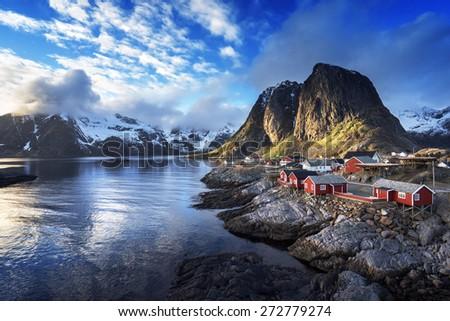 Fishing hut at spring sunset - Reine, Lofoten islands, Norway - stock photo