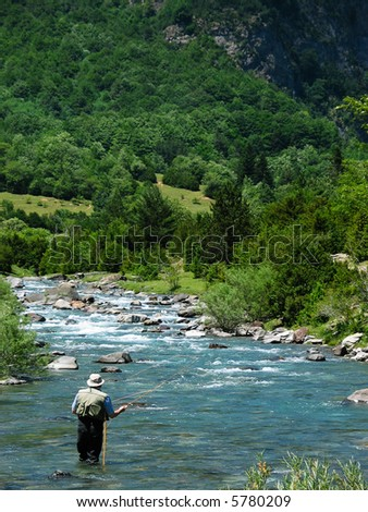 Fishing in a river - stock photo
