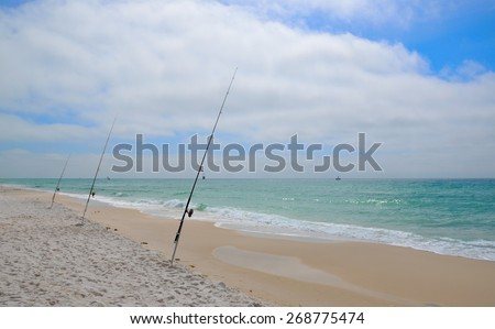 Fishing in the Gulf of Mexico on the white sand beaches of the Florida Coast - stock photo