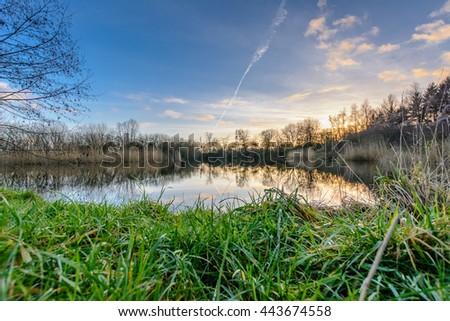 Fishing lake in evening light - stock photo