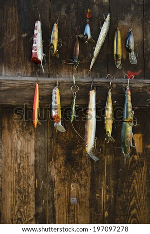 Fishing lure hanging on wall, Sandham, Sweden - stock photo