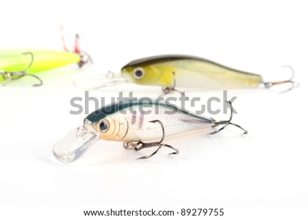 Fishing lures stick baits minnow with hooks. On white background - stock photo
