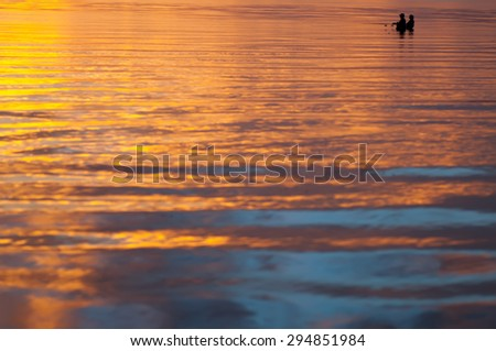 fishing man silhouette on sunset, natural background with place for text - stock photo