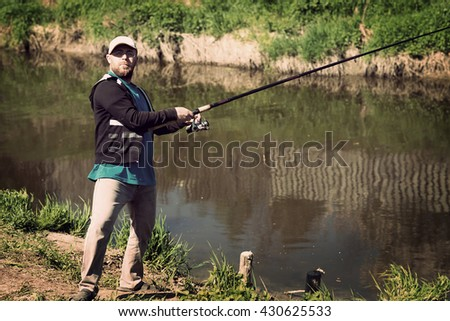 Fishing, man with fishing rod. River, outdoor