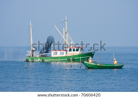 Fishing men at work at the Dutch sea - stock photo