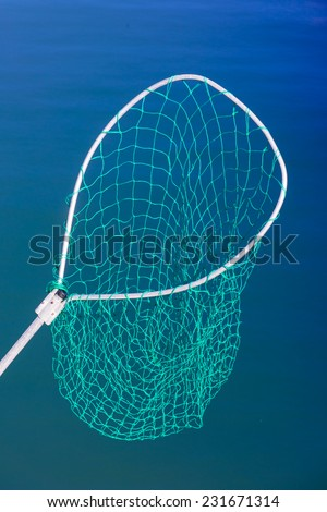 Fishing Net Against Ocean Water Background - stock photo