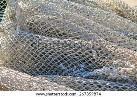 Fishing net in harbor. - stock photo