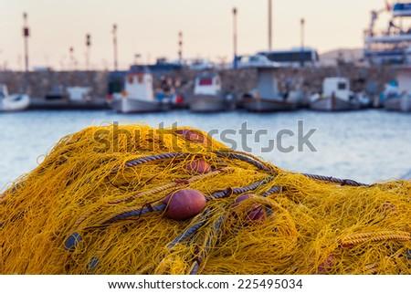 Fishing net on the dock near the sea ... - stock photo