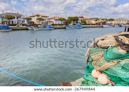 Fishing nets, fishing boats in the background - stock photo
