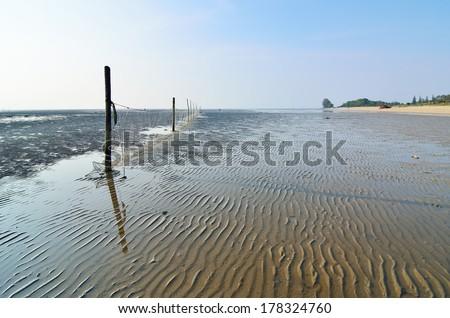 Fishing nets on the beach - stock photo