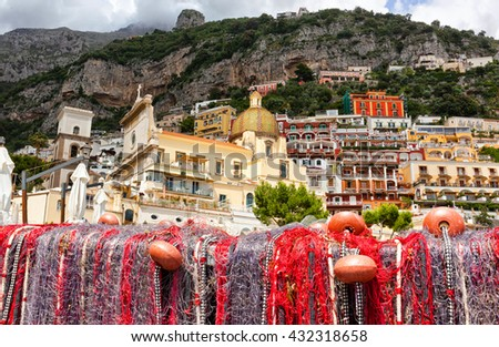 Fishing nets on the beach of Positano, Italy. view of Dome.