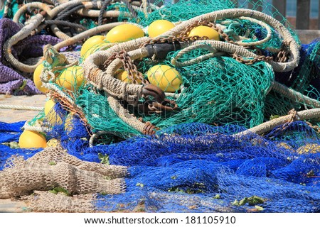 Fishing nets stretched in a port - stock photo