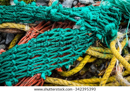 fishing nets tangled on a Russian beach - stock photo