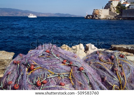 Fishing network on a pier in a bay of island the Hydra, Greece