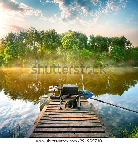 Fishing on a calm river in the morning - stock photo