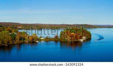 Fishing on lake in fall  - stock photo