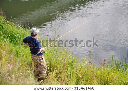Fishing on the river - stock photo