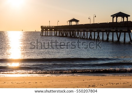 Kids place slide park sun setting stock photo 608785994 for Buckroe beach fishing pier