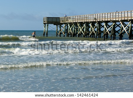 Wooden fishing pier posts stock photos wooden fishing for Isle of palms fishing pier