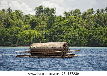fishing platform in the middle of the sea in indonesia - stock photo