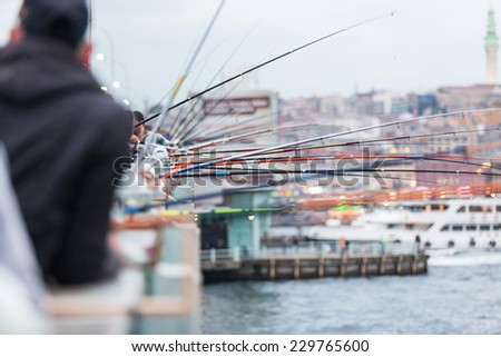 Fishing poles on Galata Bridge in Istanbul - stock photo