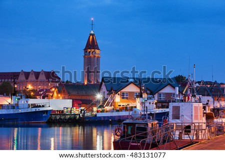 Fishing port in Wladyslawowo, Poland, city skyline with Fisherman House Tower at night, popular resort town at the Baltic Sea, Europe