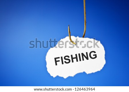 Fishing printed on white piece of paper hanging on a fishing hook over blue background. Hooked on fishing concept. - stock photo