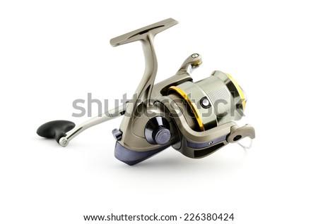 fishing reel isolated on white - stock photo