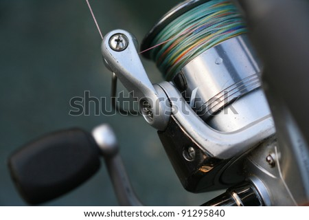 Fishing reel with co-filament line on it. Setup for fish casting (angling) - stock photo