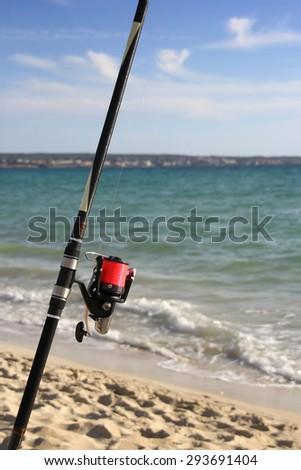 Fishing rod on a beach - stock photo