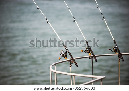 fishing rod on the river, fishing and tackle. Catching carp river fish - stock photo