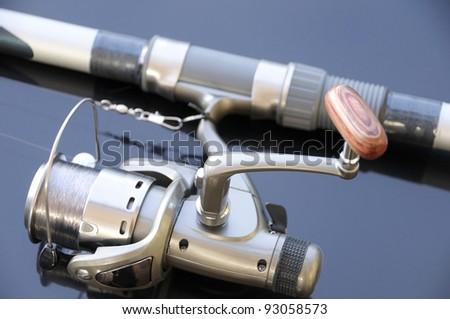 Fishing rod & reel. Short depth of field. - stock photo
