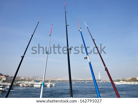 Fishing rods on the Galata Bridge crossing th Golden Horn in Istanbul, Turkey