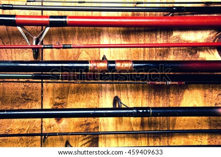 Fishing rods stacked in lines