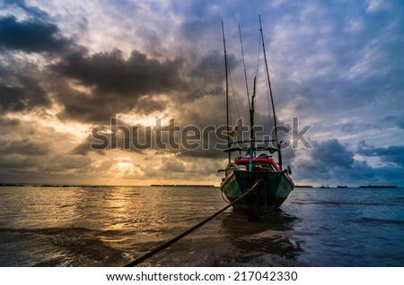Fishing sea boat and Sunrise clouds before strom in Thailand blue  light tone - stock photo