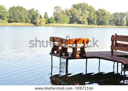 Fishing set on a wooden pier - stock photo