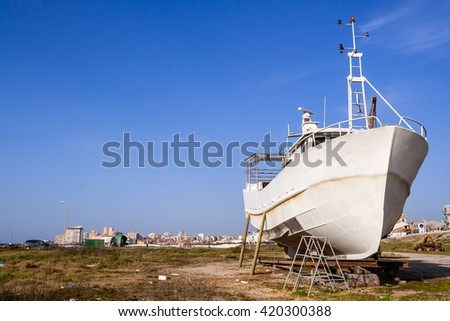 Fishing ship, a trawler being built or under maintenance in Povoa de Varzim, Portugal. - stock photo