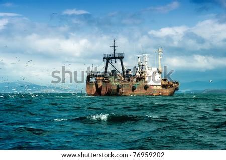 fishing ship during a fishing in japan sea - stock photo