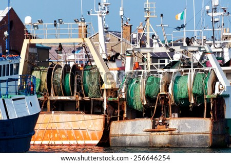 Fishing ships in the harbor - stock photo