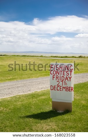 Fishing sign on the Coromandel Peninsula, New Zealand - travel and tourism.