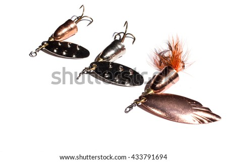 Fishing spinner lures on the white background - stock photo