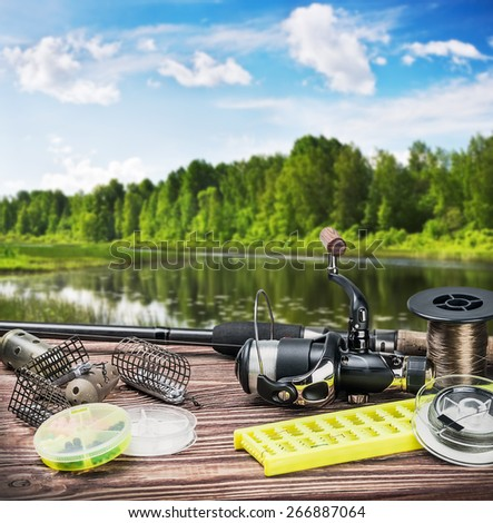 fishing tackle and accessories on the table summer day - stock photo