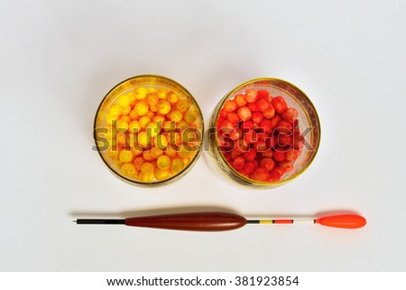 fishing tackle on a white table - stock photo