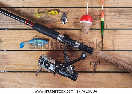 fishing tackle on a wooden table - stock photo