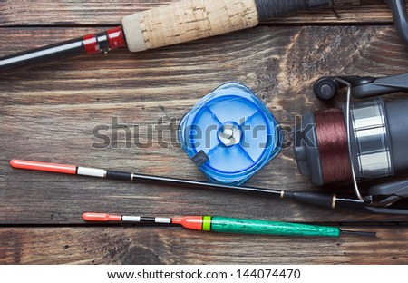 fishing tackle on a wooden table. Focus on the float. - stock photo