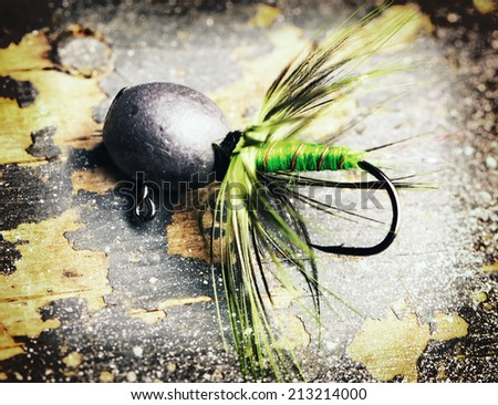 fishing tackle on the table . - stock photo