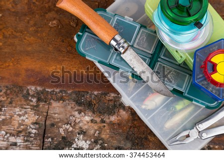 fishing tackles and baits in storage boxes - stock photo