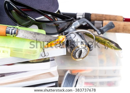 fishing tackles and baits with books on white background for outdoor business