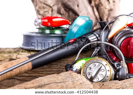 fishing tackles and fishing baits on wooden background. Idea for angling sport business - templates, web, poster, card, advertisement. - stock photo